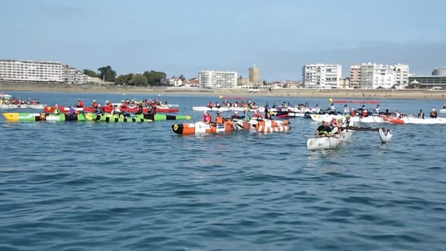 256 paddlers divided into 26 international crews take part in a Polynesian pirogue race during the 10th edition of the Vendee Va'a in Les...