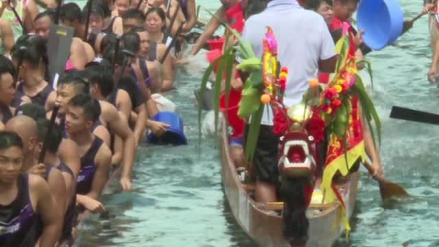 paddlers take part in the annual dragon boat race in the aberdeen typhoon shelter in hong kong to celebrate the tuen ng festival - aberdeen hong kong stock videos & royalty-free footage