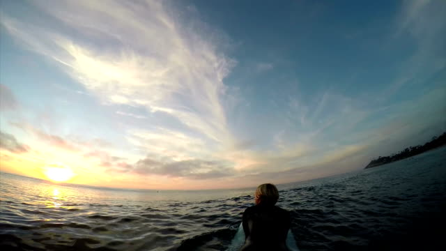 paddling out - longboarding stock videos & royalty-free footage