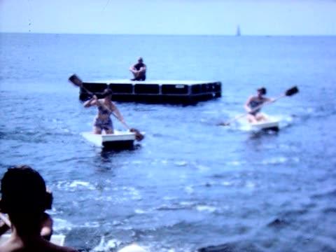 1950 paddling skiffs on a lake - floating moored platform stock videos & royalty-free footage