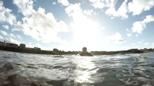 paddling through the waves - paddling stock videos and b-roll footage