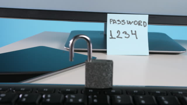 padlock on computer keyboard - post it video stock e b–roll