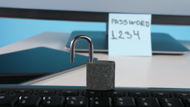 padlock on computer keyboard - password stock videos & royalty-free footage