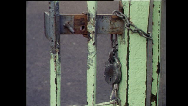 cu of padlocked school gate with worn paint; 1972 - playground stock videos & royalty-free footage