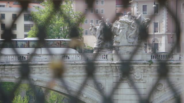 ms r/f padlocks and bus moving on bridge / rome, italy - サンタンジェロ橋点の映像素材/bロール