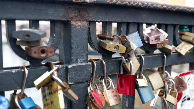 padlocks on a bridge - lock stock videos and b-roll footage