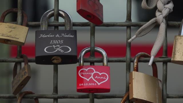 padlocks on hohenzollern bridge, cologne, north rhine westphalia, germany - western script stock videos & royalty-free footage