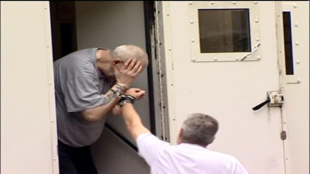 stockvideo's en b-roll-footage met paedophile rapist robert smith jailed for 20 years england york york crown court ext robert smith led from police van in handcuffs as puts his hand... - bewegingsbeperkende middelen