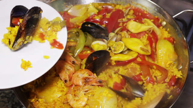 Paella cooking in a pan