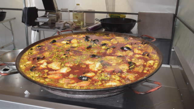 paella cooking on street market - apt stock videos and b-roll footage