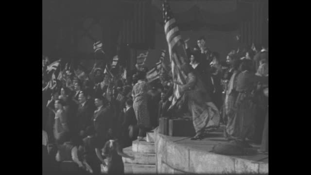 "vidéos et rushes de pageant ""the romance of a people"" being performed on huge stage at soldier field, cast of thousands rejoicing and flags waving during this... - nazism"
