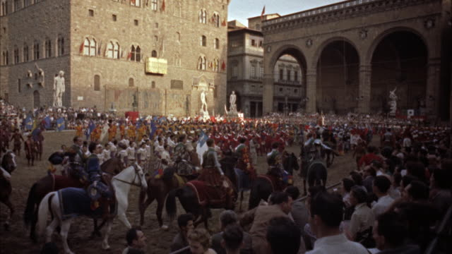 ws pageantry before and start of  football game / florence, italy  - 1954年点の映像素材/bロール