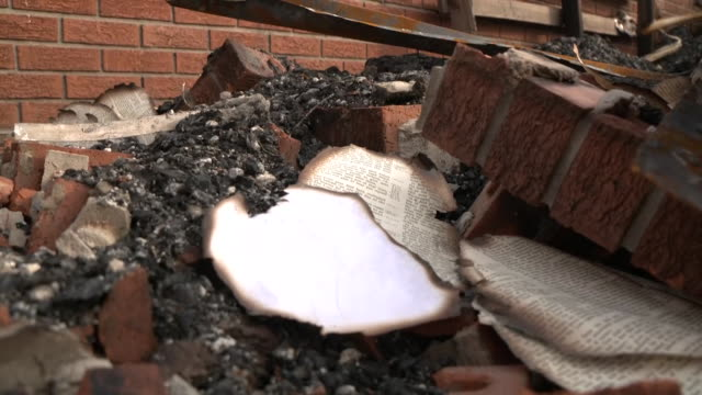pages from a burned bible seen in the debris after a fire at st. maryõs baptist church in opelousas, louisiana on april 6, 2019. - バプテスト点の映像素材/bロール