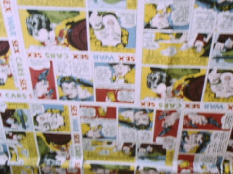 Pages from comics decorate the ceiling of Gear a gift shop in Carnaby Street