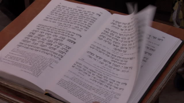 Pages in Torah blow in light breeze