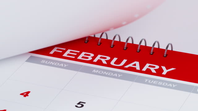 pages of a calendar are flying away in 4 k resolution - month stock videos & royalty-free footage
