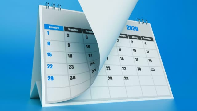 pages of a calendar are flying away on blue background - calendar stock videos & royalty-free footage