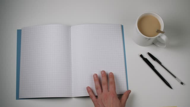 pages of notebook with squared paper are turned - turning stock videos & royalty-free footage