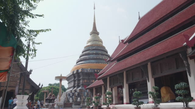pagoda and church in wat prathat lampang luang,lampang province thailand - cambodian culture stock videos and b-roll footage