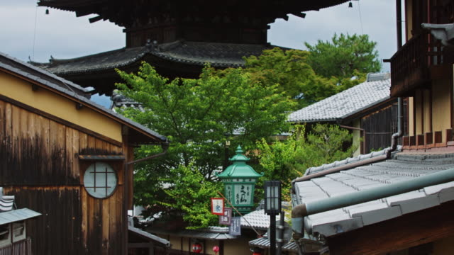 pagoda rising over japanese street - kyoto temple stock videos and b-roll footage