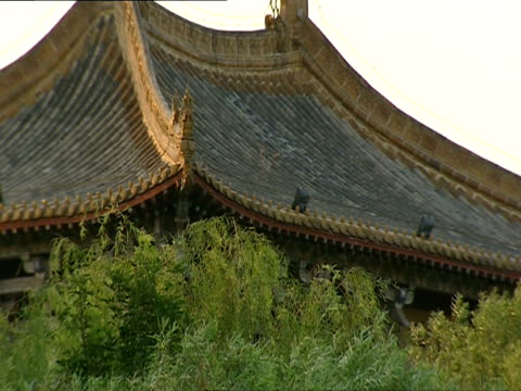cu, pagoda style roof rising above trees, china - pagoda stock videos & royalty-free footage