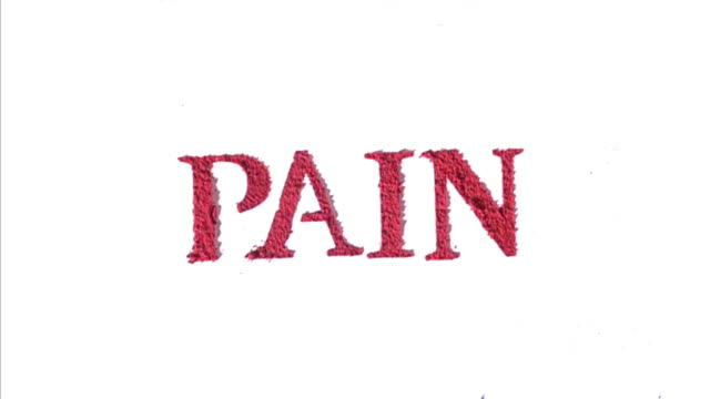 Pain written in red exploding text in slow motion.