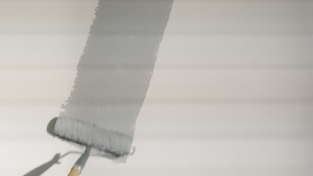 paint roller painting a wall - paint roller stock videos & royalty-free footage