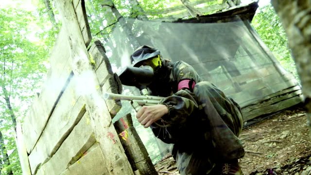 Paintball Player Shooting At Opponents