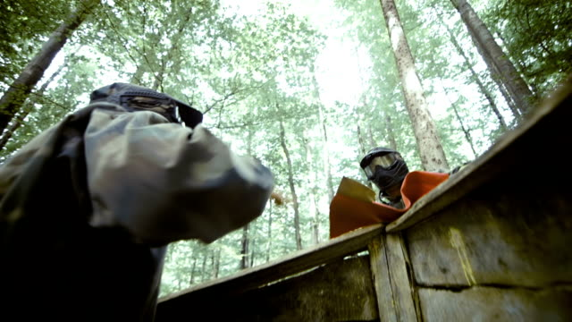 Paintball Players Giving High Five