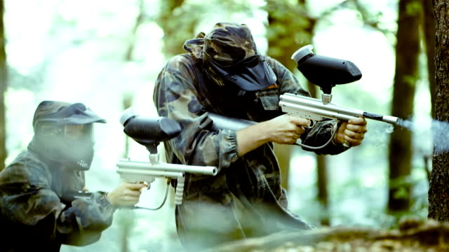 Paintball Players Shooting At Opponents