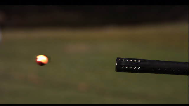 a paintball shoots from a gun barrel. - gun barrel stock videos & royalty-free footage