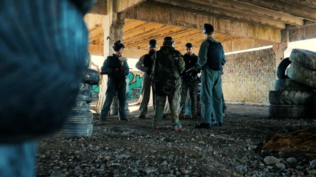 paintball team discussing about strategy - pursuit sports competition format stock videos and b-roll footage