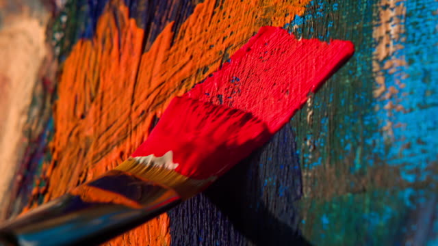 Paintbrush with oil paint on classical canvas