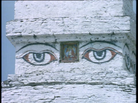 painted eyes on spire of buddhist temple seen through heat haze, himalayas - spire stock videos & royalty-free footage