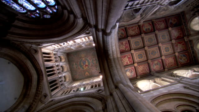 painted panels adorn the ceiling of the southwest transept in the ely cathedral. available in hd. - doorway stock videos and b-roll footage