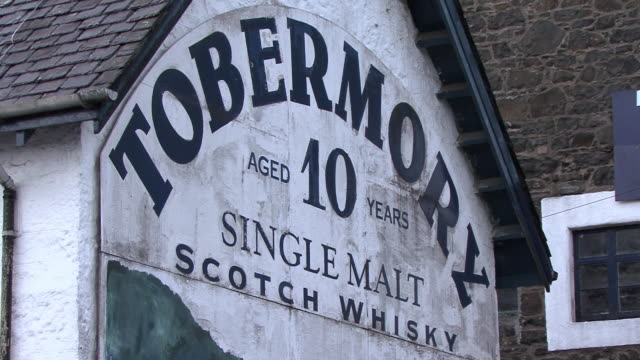 cu painted sign on wall of tobermory distillery advertising whiskey / tobermory, scotland, united kingdom - distillery stock videos and b-roll footage