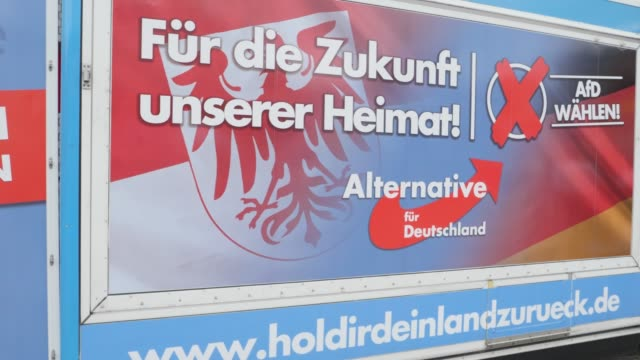 painted truck of the rightwing alternative for germany with the inscription preserve home dare change at an election campaign in the state of... - engraved image stock videos and b-roll footage