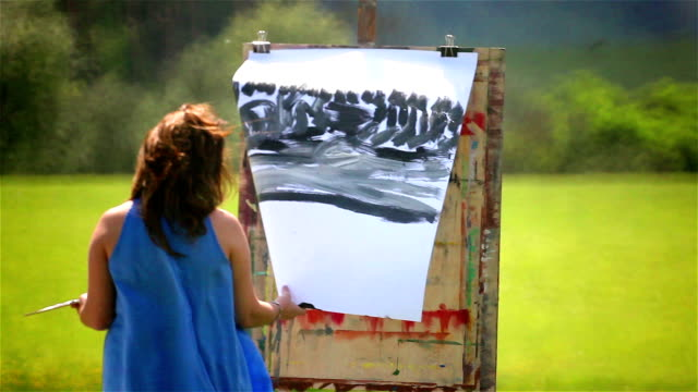 painter challenging weather conditions outdoors - artist stock videos & royalty-free footage