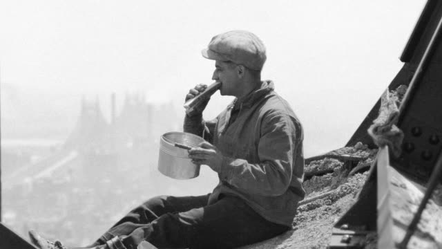 a painter eats lunch on the ledge of a new york city skyscraper under construction. - lunch break stock videos & royalty-free footage
