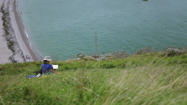 a painter facing etretat beach in normandy - france - allied forces stock videos & royalty-free footage