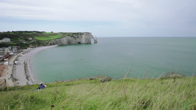 a painter on the cliff of etretat in normandy - france - allied forces stock videos & royalty-free footage