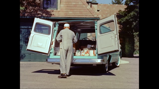 ms painter opening door of van and walking with paint can / united states - house painter stock videos and b-roll footage