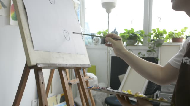 painter painting in studio - human limb stock videos & royalty-free footage