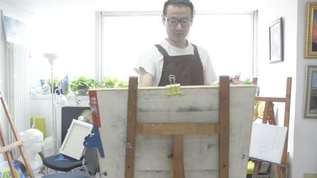 painter painting in studio