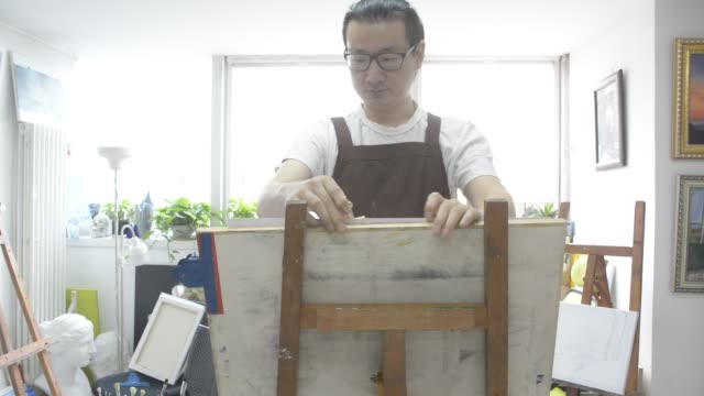 painter painting in studio