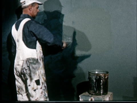 ms, painter painting wall - bib overalls stock videos and b-roll footage