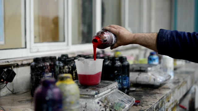 painter pouring red paint - ozgurdonmaz stock videos and b-roll footage