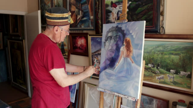 painter retouching his art work at his home studio - art class stock videos & royalty-free footage