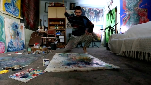 painter splashing on painting - art studio stock videos & royalty-free footage