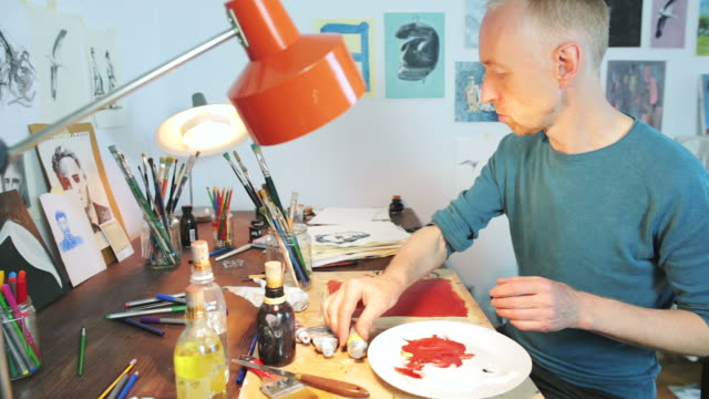 Painter working in his workshop.